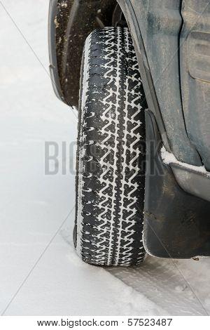 Wheel In Deep Winter Snow Snowbank