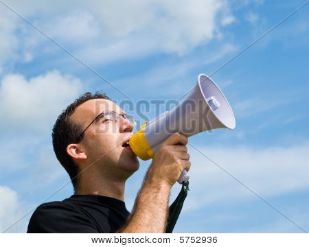 Man Talking Into Megaphone