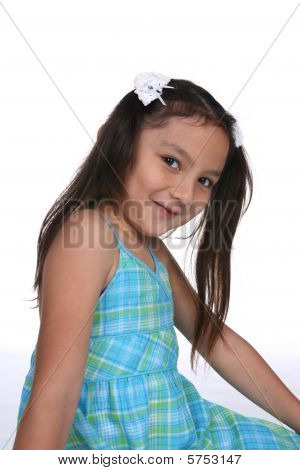 Pretty Girl With Long Pigtails And A Cute Grin