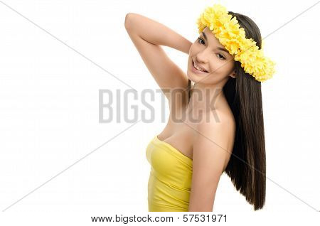 Portrait of a sexy woman with wreath of yellow flowers on the head. Girl with long straight hair.