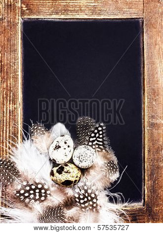 Quail Eggs On Vintage Blackboard Close Up. Easter Symbol With Copy Space For Greeting Text. Easter Q