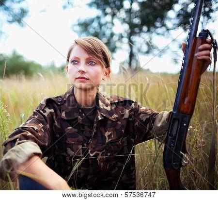 Young Beautiful Girl With A Shotgun