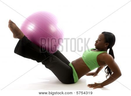 Young Pretty Hispanic African American Woman Exercising With Fitness Core Ball