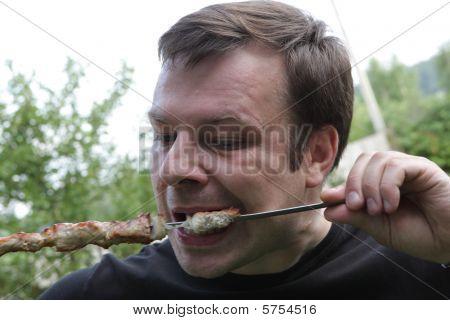 Man Eats Kebab
