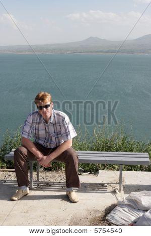 Man Resting On Bench