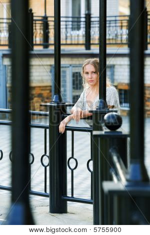 Thoughtful Woman Against A Railing.