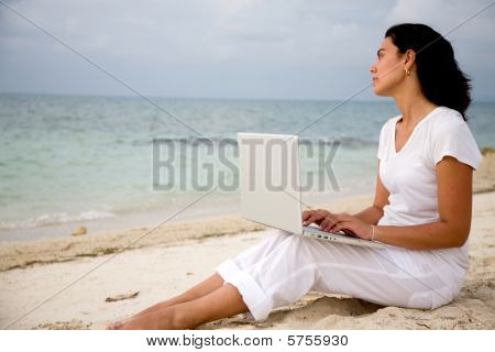 Woman Working At The Beach