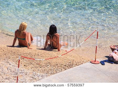 Girls In The Baska Beach, Croatia
