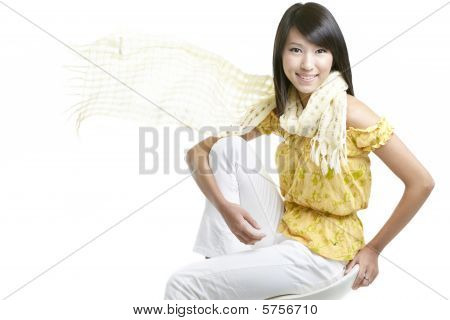 Japanese Beauty With Windswept Hair And Yellow Scarf