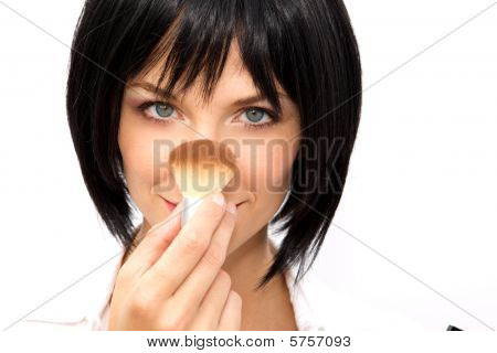 Beautiful Woman Applying Blush
