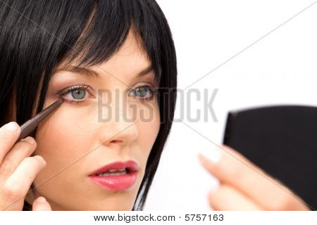 Beautiful Woman Applying Eyeliner