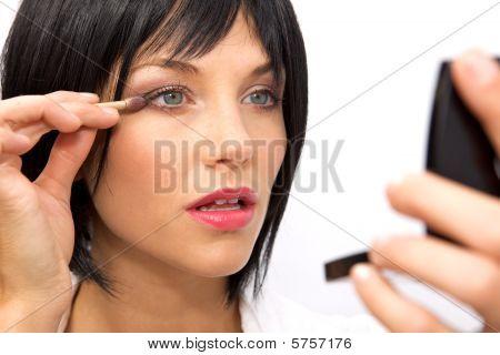 Beautiful Woman Applying Eyeshadow