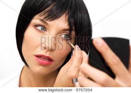 Beautiful Woman Applying Eyeshadow