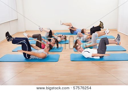 Group Of People Exercsning In A Gym Class