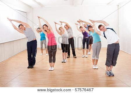 Pilates Class Exercising In A Gym