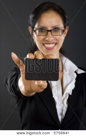 Closeup Of An Attractive Businesswoman Presenting A Card