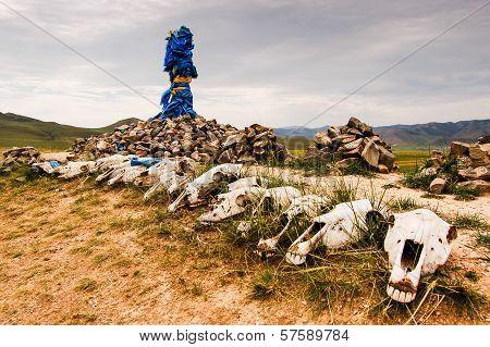 Mongolian Stone Shrine, Ceremonial Prayer Flags And Horse Skulls