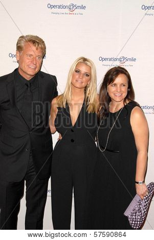 Joe Simpson with Jessica Simpson and Tina Simpson at Operation Smile's 8th Annual Smile Gala. Beverly Hilton Hotel, Beverly Hills, CA. 10-02-09