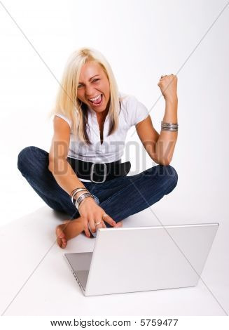 Smiling Women sitting at laptop