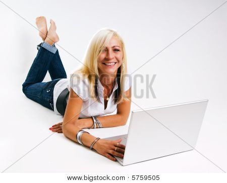 Smiling Women sitting at laptop