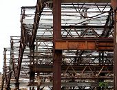 picture of girder  - Rusting beams and girders of a deserted factory building - JPG