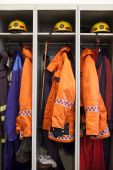 foto of medevac  - Fire fighter suits at the fire station.
