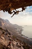Rock climber at sunset, Kalymnos, Greece