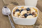 picture of mixed nut  - Mixed Muesli with Nuts and Fruits on wooden background - JPG