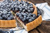 image of tarts  - Delicious Blueberry Tart with fresh fruits (close-up shot)