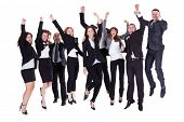 stock photo of reaction  - Group of jubilant business people jumping for joy and shouting in their excitement at their success isolated on white - JPG