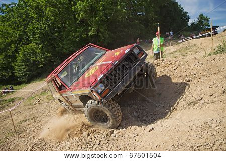 Red Offroad Car Is In Great Lateral Tilt