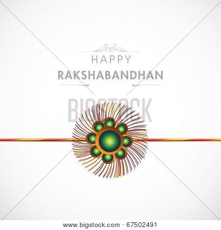 Beautiful Rakhi on grey background on the occasion of Happy Raksha Bandhan celebration.
