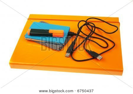 orange folder external hard disk and marker