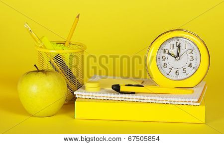 Stationery, books and apple