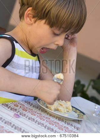 boy eating tasteful cake