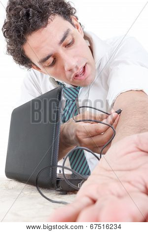 Business Man In Suit Addicted To Internet Put Usb Cable From Laptop Computer Into His  Arm Vein And