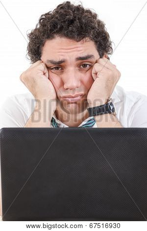 Man Frustrated With Work Sitting In Front Of A Laptop With His Hands On Face Cheeks
