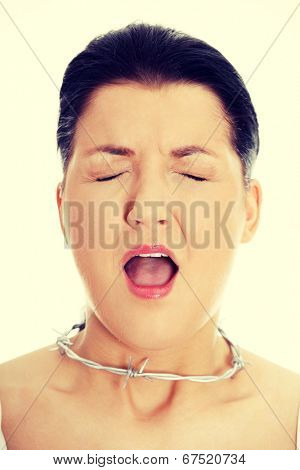 Throat pain concept. Young woman with barbed wire around her throat.