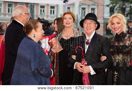 MOSCOW - JUNE, 28: N. Mikhalkov, V. Sotnikova, designer V. Zaitsev and model. 36st Moscow International Film Festival. Closing Ceremony at Rossiya Cinema . June 28, 2014 in Moscow, Russia