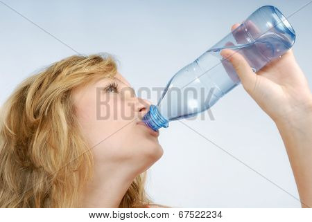 Girl Is Drinking From A Bottle