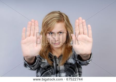 Young Woman Lifts Hands In Defense