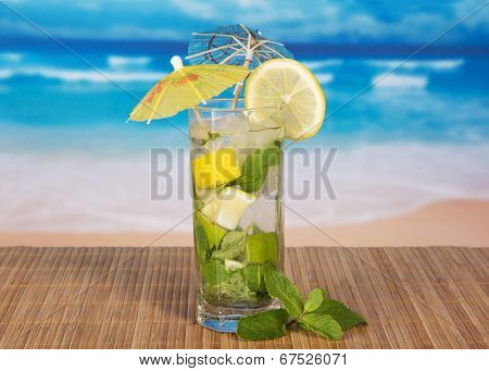 Green cocktail of alcohol with an umbrella