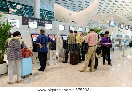 SHENZHEN, CHINA - APRIL 16: airport interior on April 16, 2014 in Shenzhen, China. Shenzhen Bao'an International Airport is located near Huangtian and Fuyong villages in Bao'an District, Shenzhen, Guangdong