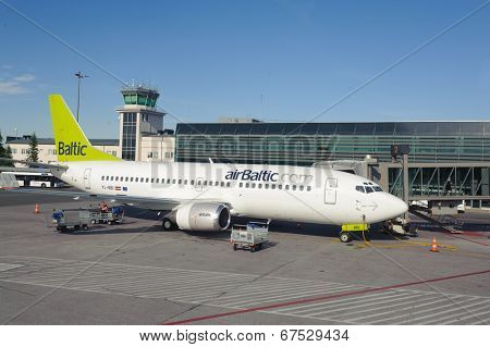 RIGA, LATVIA - JUNE 13, 2011: airBaltic Boeing 737 docked in Riga airport. June 13, 2011. AirBaltic operates about 60 direct flights from Riga.