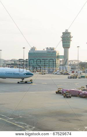 HONG KONG - APRIL 17: control tower and Cathay Pacific jet flight on April 17, 2014 in Hong Kong. Cathay Pacific is the international flag carrier of Hong Kong