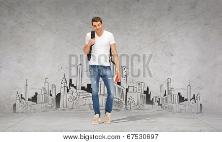 travel, vacation and education concept - smiling student with backpack and travel guide