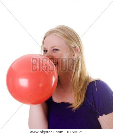 Young Woman Blowing Red Balloon