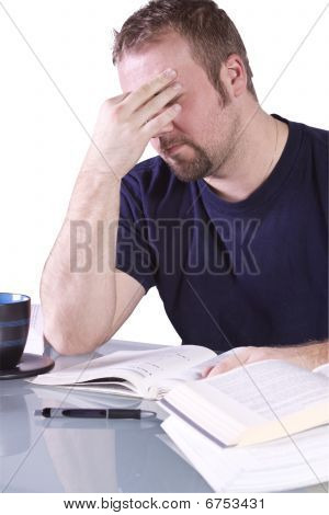 Frustrated College Student With Books On The Table Studying