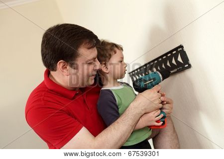 Father And Son Installing Mount Tv
