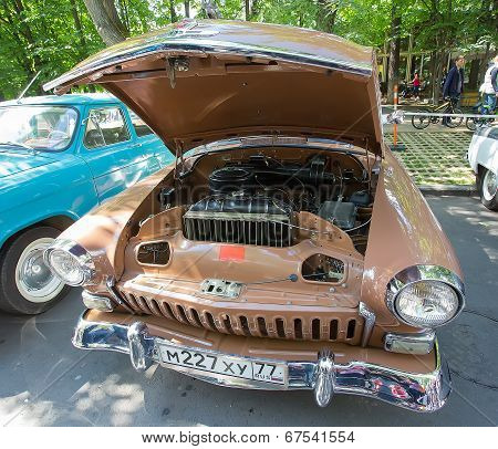 The GAZ-21 Volga car with an open motor compartment on show of collection Retrofest cars